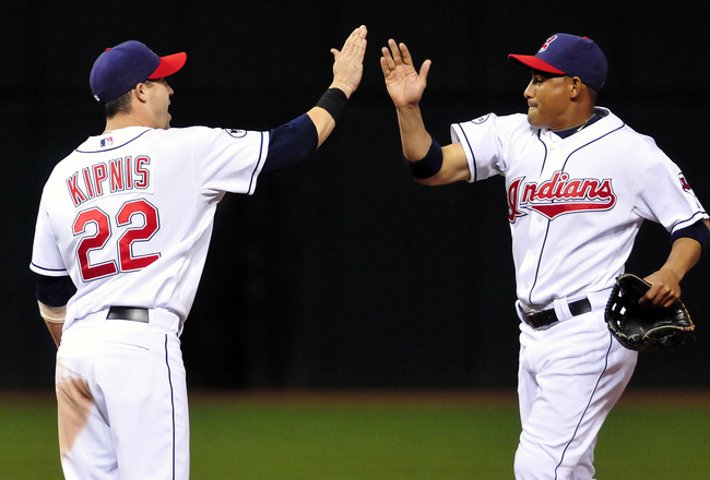 CLEVELAND, OH - AUGUST 10: Second baseman Jason Kipnis #22 celebrates with Ezequiel Carrera #12 of the Cleveland Indians after they defeated the Detroit Tigers 10-3 at Progressive Field on August 10, 2011 in Cleveland, Ohio. (Photo by Jason Miller/Getty I