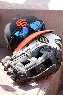 CINCINNATI, OH - JULY 31:  The glove and hat of Carlos Beltran #15 of the San Francisco Giants sit on the dugout steps during the game against the Cincinnati Reds at Great American Ball Park on July 31, 2011 in Cincinnati, Ohio.  (Photo by Andy Lyons/Gett