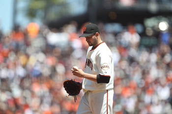 SAN FRANCISCO, CA - AUGUST 10:  Jonathan Sanchez #57 of the San Francisco Giants looks on after giving up three runs in the third inning against the Pittsburgh Pirates at AT&T Park on August 10, 2011 in San Francisco, California.  (Photo by Jed Jacobsohn/