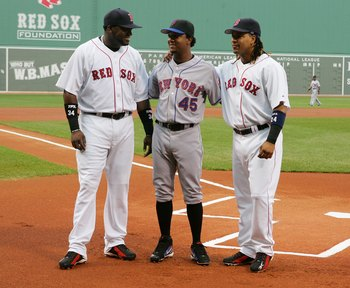 BOSTON - JUNE 29:  David Ortiz #34 (L) and Manny Ramirez #24 of the Boston Red Sox pose with former teammate Pedro Martinez #45 of the New York Mets before their game on June 29, 2006 at Fenway Park in Boston, Massachusetts.  (Photo by Jim McIsaac/Getty I