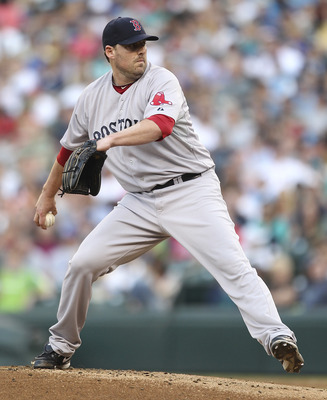 SEATTLE - AUGUST 12:  Starting pitcher John Lackey #41 of the Boston Red Sox pitches against the Seattle Mariners at Safeco Field on August 12, 2011 in Seattle, Washington. (Photo by Otto Greule Jr/Getty Images)