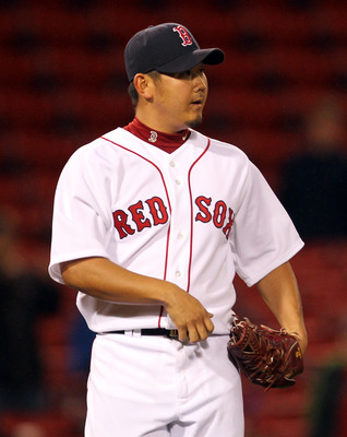 BOSTON, MA - MAY 04:  Daisuke Matsuzaka #18 of the Boston Red Sox reacts after giving up a single to Peter Bourjos #25 of the Los Angeles Angels of Anaheim at Fenway Park on May 4, 2011 in Boston, Massachusetts. (Photo by Jim Rogash/Getty Images)