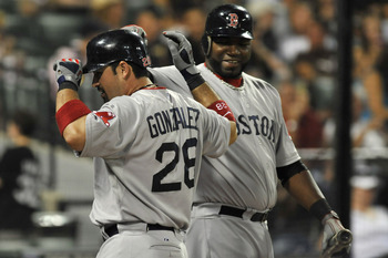CHICAGO, IL - JULY 30:  Adrian Gonzalez #28 of the Boston Red Sox is greeted by teammate David Ortiz #34 after hitting a two-run home run in the ninth inning against the Chicago White Sox on July 30, 2011 at U.S. Cellular Field in Chicago, Illinois.  (Pho