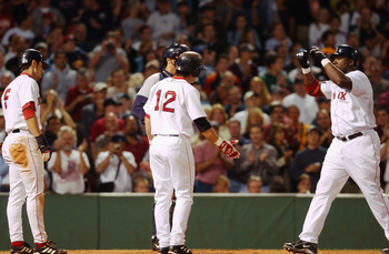BOSTON, MA- AUGUST 24:  Boston Red Sox shortstop Nomar  Garciaparra #5 and second baseman Todd Walker #12 congratulate DH David Ortiz #34 after a 4th inning 3 run blast during the game against the Seattle Mariners at Fenway Park in Boston, Massachusetts.