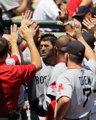 CHICAGO, IL - JULY 31:  Jason Varitek #33 of the Boston Red Sox is greeted by teammates in the dugout after hitting a two-run home run in the 2nd inning against the Chicago White Sox at U.S. Cellular Field on July 31, 2011 in Chicago, Illinois.  (Photo by