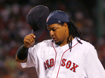 BOSTON - JULY 30: Manny Ramirez #24 of the Boston Red Sox walks off of the field during action against  the Los Angeles Angels of Anaheim at Fenway Park on July 30, 2008 in Boston, Massachusetts.  (Photo by Jim Rogash/Getty Images)