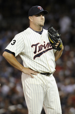 MINNEAPOLIS, MN - AUGUST 9: Matt Capps #55 of the Minnesota Twins reacts to walking the bases full in the seventh inning against the Boston Red Sox on August 9, 2011 at Target Field in Minneapolis, Minnesota. The Red Sox defeated the Twins 4-3. (Photo by