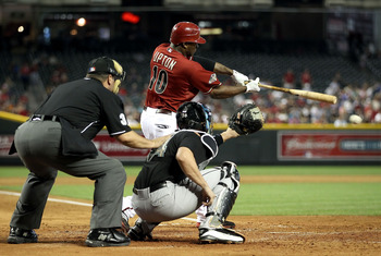 PHOENIX, AZ - JUNE 01:  Justin Upton #10 of the Arizona Diamondbacks hits a RBI ground ball out against the Florida Marlins during the sixth inning of the Major League Baseball game at Chase Field on June 1, 2011 in Phoenix, Arizona.  The Diamondbacks def