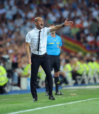 MADRID, SPAIN - AUGUST 14: Barcelona head coach Josep Guardiola shouts instructions at his team during the Super Cup first leg match between Real Madrid and Barcelona at Estadio Santiago Bernabeu on August 14, 2011 in Madrid, Spain.  (Photo by Denis Doyle