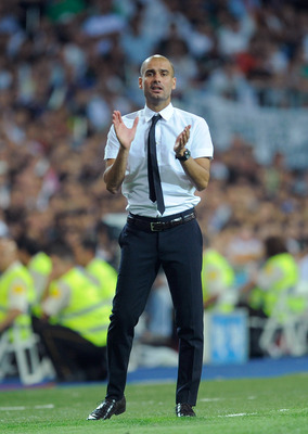 MADRID, SPAIN - AUGUST 14:  Barcelona head coach Josep Guardiola applauds his team during the Super Cup first leg match between Real Madrid and Barcelona at Estadio Santiago Bernabeu on August 14, 2011 in Madrid, Spain.  (Photo by Denis Doyle/Getty Images