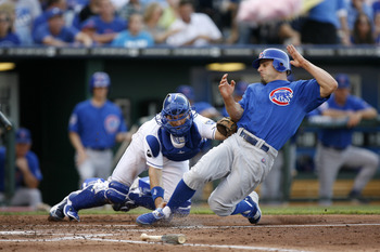 KANSAS CITY, MO - JUNE 25:  Reed Johnson #5 of the Chicago Cubs is tagged out by Matt Treanor #15 of the Kansas City Royals as he tries to score at Kauffman Stadium on June 25, 2011 in Kansas City, Missouri. (Photo by Ed Zurga/Getty Images)