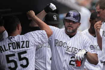 DENVER, CO - JULY 17:  Jason Giambi #23 of the Colorado Rockies celebrates his solo homerun in the sixth inning with catcher Eliezer Alfonzo #55 of the Colorado Rockies against the Milwaukee Brewers at Coors Field on July 17, 2011 in Denver, Colorado. The