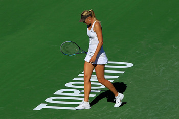 TORONTO, ON - AUGUST 11: Maria Sharapova of Russia reacts on court during her match against Galina Voskoboeva of Kazakhstan on Day 4 of the Rogers Cup presented by National Bank at the Rexall Centre on August 11, 2011 in Toronto, Ontario, Canada.  (Photo