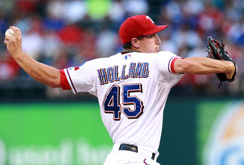 ARLINGTON, TX - AUGUST 10:  Derek Holland #45 of the Texas Rangers throws against the Seattle Mariners at Rangers Ballpark in Arlington on August 10, 2011 in Arlington, Texas.  (Photo by Ronald Martinez/Getty Images)