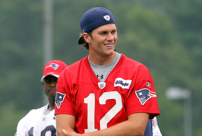 FOXBOROUGH, MA  - JULY 29:  Tom Brady #12 of the New England Patriots participates in training camp at Gillette Stadium on July 29, 2011 in Foxborough, Massachusetts.  (Photo by Jim Rogash/Getty Images)