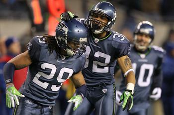 SEATTLE, WA - JANUARY 02:  Safety Earl Thomas #29 and cornerback Marcus Brown #32 of the Seattle Seahawks celebrate a defensive play against the St. Louis Rams during their game at Qwest Field on January 2, 2011 in Seattle, Washington.  (Photo by Otto Gre