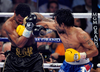 Shane Mosley and Manny Pacquiao during their fight in May 2011