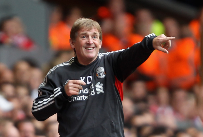 LIVERPOOL, ENGLAND - AUGUST 13:  Liverpool manager Kenny Dalglish directs his team during the Barclays Premier League match between Liverpool and Sunderland at Anfield on August 13, 2011 in Liverpool, England.  (Photo by Clive Brunskill/Getty Images)