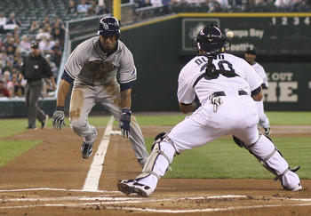 SEATTLE, WA - JULY 31:  Desmond Jennings #8 of the Tampa Bay Rays scores on a fielders choice by Evan Longoria #3 against catcher Miguel Olivo #30 of the Seattle Mariners at Safeco Field on July 31, 2011 in Seattle, Washington. (Photo by Otto Greule Jr/Ge