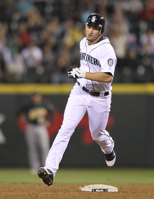 SEATTLE - AUGUST 02:  Casper Wells #33 of the Seattle Mariners rounds second base on a two-run homer against the Oakland Athletics in the sixth inning at Safeco Field on August 2, 2011 in Seattle, Washington. (Photo by Otto Greule Jr/Getty Images)