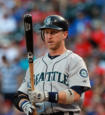 ARLINGTON, TX - AUGUST 09:  Mike Carp #20 of the Seattle Mariners at Rangers Ballpark in Arlington on August 9, 2011 in Arlington, Texas.  (Photo by Ronald Martinez/Getty Images)