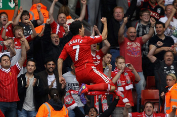 Luis Suarez celebrates scoring the opening goal of Liverpool's new season