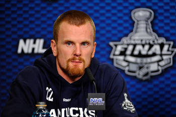 VANCOUVER, BC - JUNE 04:  Daniel Sedin #22 of the Vancouver Canucks speaks to the media after defeating the Boston Bruins in Game Two of the 2011 NHL Stanley Cup Final at Rogers Arena on June 4, 2011 in Vancouver, British Columbia, Canada.  (Photo by Rich