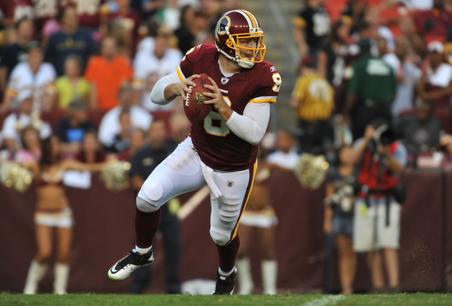 LANDOVER, MD - AUGUST 12:  Rex Grossman #8 of the Washington Redskins looks to pass against the Pittsburgh Steelers  at FedExField on August 12, 2011 in Landover, Maryland. The Redskins defeated the Steelers 16-7. (Photo by Larry French/Getty Images)