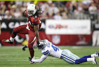 GLENDALE, AZ - DECEMBER 25:  Runningback Tim Hightower #34 of the Arizona Cardinals runs with the football during the NFL game against the Dallas Cowboys at the University of Phoenix Stadium on December 25, 2010 in Glendale, Arizona.  The Cardinals defeat