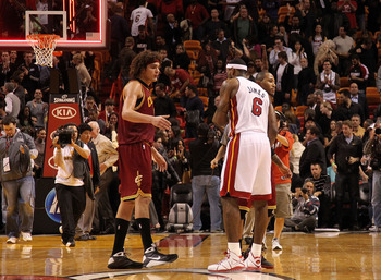 MIAMI, FL - DECEMBER 15:  LeBron James #6 of the Miami Heat shakes hands with Mo Williams #2 and Anderson Varejao #17 of the Cleveland Cavaliers during a game at American Airlines Arena on December 15, 2010 in Miami, Florida. NOTE TO USER: User expressly