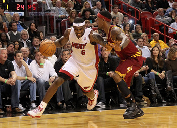MIAMI, FL - DECEMBER 15:  LeBron James #6 of the Miami Heat dribbles around Daniel Gibson #1 of the Cleveland Cavaliers during a game  at American Airlines Arena on December 15, 2010 in Miami, Florida. NOTE TO USER: User expressly acknowledges and agrees