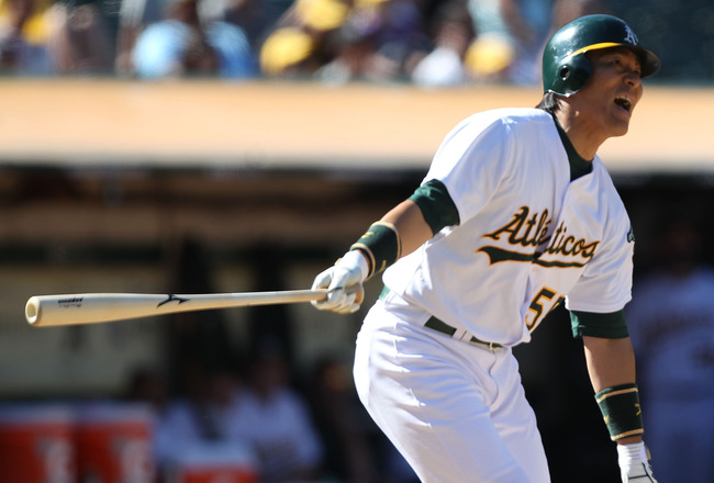 OAKLAND, CA - AUGUST 14:  Hideki Matsui #55 of the Oakland Athletics hits a foul ball against the Texas Rangers at O.co Coliseum on August 14, 2011 in Oakland, California.  (Photo by Jed Jacobsohn/Getty Images)