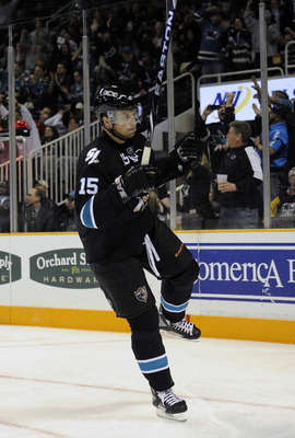 SAN JOSE, CA - MARCH 3: Dany Heatley #15 of the San Jose Sharks celebrates after scoring his second goal against the Detroit Red Wings in the second period of an NHL hockey game at the HP Pavilion on March 3, 2011 in San Jose, California. The Sharks won t