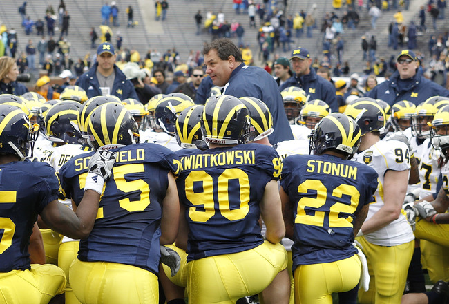 ANN ARBOR, MI - APRIL 16:  Head football coach Brady Hoke talks with his team during the annual Spring Game at Michigan Stadium on April 16, 2011 in Ann Arbor, Michigan.  (Photo by Leon Halip/Getty Images)