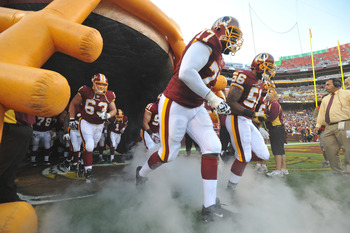 LANDOVER, MD - AUGUST 12:  Jammal Brown #77 of the Washington Redskins takes the field before the game against the Pittsburgh Steelers  at FedExField on August 12, 2011 in Landover, Maryland. The Redskins defeated the Steelers 16-7. (Photo by Larry French