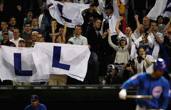 CHICAGO, IL - JUNE 22: Fans of the Chicago White Sox hold 'L' flags, flown at Wrigley Field when the Chicago Cubs lose, as Carlos Pena #22 of the Cubs strikes out to end the game at U.S. Cellular Field on June 22, 2011 in Chicago, Illinois. The White Sox