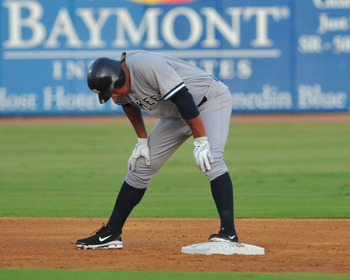 DUNEDIN, FL - AUGUST 12:  Designated hitter Alex Rodriguez #13 of the Tampa Yankees pauses after a double in the third inning against the Dunedin Blue Jays  August 12, 2011 at Florida Auto Exchange Stadium in Dunedin, Florida. Rodriguez played during a re