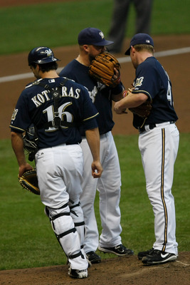 MILWAUKEE, WI - AUGUST 15: Randy Wolf #43 of the Milwaukee Brewers talks with Casey McGehee #14 and George Kottaras #16 against the Los Angeles Dodgers at Miller Park on August 15 2011 in Milwaukee, Wisconsin. (Photo by Scott Boehm/Getty Images)