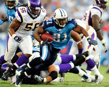 NASHVILLE, TN - AUGUST 13:  Javon Ringer #21 of the Tennessee Titans breaks away from the Minnesota Vikings defense during a preseason exhibition game at LP Field on August 13, 2011 in Nashville, Tennessee.  (Photo by Grant Halverson/Getty Images)