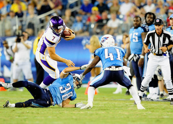 NASHVILLE, TN - AUGUST 13:  Quarterback Christian Ponder #7 of the Minnesota Vikings hurdles Pete Ittersagen #38 of the Tennessee Titans during a preseason game at LP Field on August 13, 2011 in Nashville, Tennessee. Tennessee defeated Minnestoa, 14-3. (P