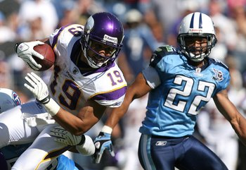 NASHVILLE, TN - SEPTEMBER 28:  Wide receiver Bobby Wade #19 of the Minnesota Vikings looks to get past safety Vincent Fuller #22 of the Tennessee Titans at LP Field on September 28, 2008 in Nashville, Tennessee. The Titans defeated the Vikings 30-17.  (Ph