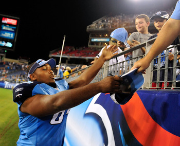 NASHVILLE, TN - AUGUST 13:  Leroy Harris #64 of the Tennessee Titans signs autographs for fans after a preseason game against the Minnesota Vikings at LP Field on August 13, 2011 in Nashville, Tennessee. Tennessee defeated Minnestoa, 14-3. (Photo by Grant