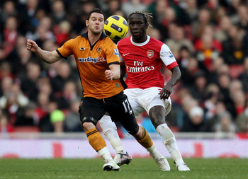 LONDON, ENGLAND - FEBRUARY 12:  Matthew Jarvis of Wolves (L) ina ction with Bacary Sagna during the Barclays Premier League match between Arsenal and Wolverhampton Wanderers on February 12, 2011 in London, England.  (Photo by Scott Heavey/Getty Images)