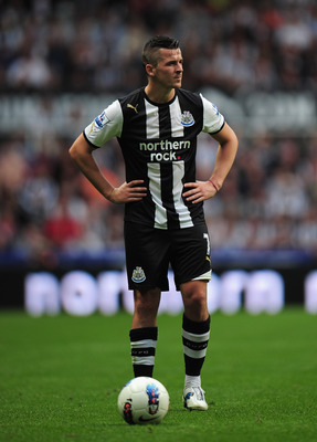 NEWCASTLE UPON TYNE, ENGLAND - AUGUST 13:  Joey Barton of Newcastle looks on during the Barclays Premier League match between Newcastle United and Arsenal at St James' Park on August 13, 2011 in Newcastle upon Tyne, England.  (Photo by Shaun Botterill/Get