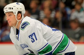 DENVER - OCTOBER 03:  Rick Rypien #37 of the Vancouver Canucks looks on against the Colorado Avalanche during NHL action at the Pepsi Center on October 3, 2009 in Denver, Colorado. The Avalanche defeated the Canucks 3-0.  (Photo by Doug Pensinger/Getty Im