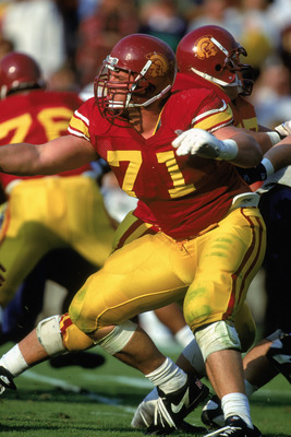 LOS ANGELES - NOVEMBER 12:  Tony Boselli #71 of the University of Southern California Trojans defends during the NCAA game against the University of Arizona Wildcats at the Los Angeles Memorial Coliseum on November 12, 1994 in Los Angeles, California.  Th