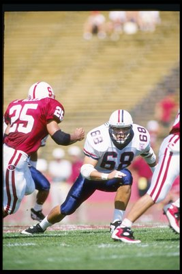 24 Sep 1994:  Defensive end Tedy Bruschi of the Arizona Wildcats tries to penetrate the offensive line during a game against the Stanford Cardinals at the Stanford Stadium in Stanford, California.  Arizona won the game 34-10. Mandatory Credit: Otto Greule