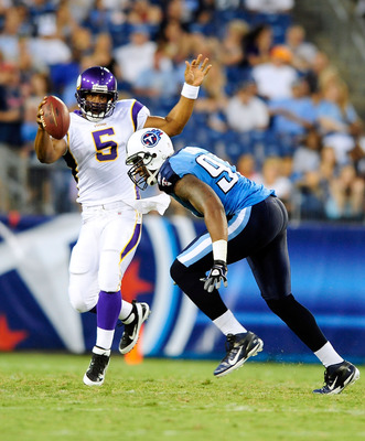 NASHVILLE, TN - AUGUST 13:  Quarterback Donovan McNabb #5 of the Minnesota Vikings avoids Jason Jones #91 of the Tennessee Titans during a preseason exhibition game at LP Field on August 13, 2011 in Nashville, Tennessee.  (Photo by Grant Halverson/Getty I