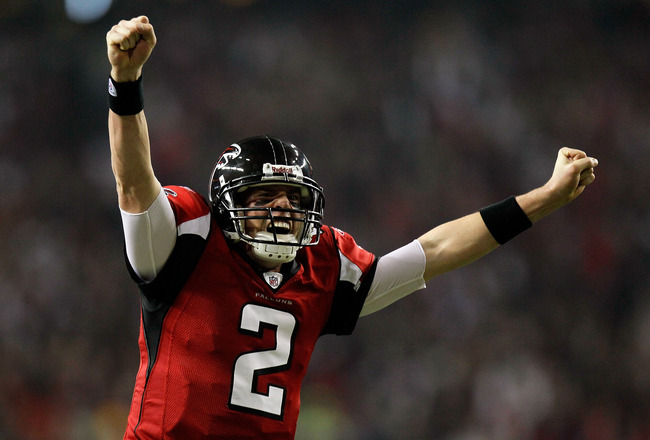 ATLANTA, GA - JANUARY 15:  Matt Ryan #2 of the Atlanta Falcons reacts after Michael Turner #33 scored a 12-yard rushing touchdown in the first quarter against the Green Bay Packers during their 2011 NFC divisional playoff game at Georgia Dome on January 1