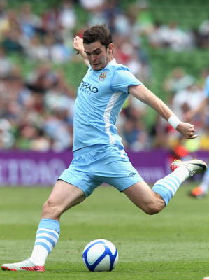 DUBLIN, IRELAND - JULY 30:  Adam Johnson of Manchester City passes the ball during the Dublin Super Cup match between Manchester City and Airtricity XI at Aviva Stadium on July 30, 2011 in Dublin, Ireland.  (Photo by David Rogers/Getty Images)